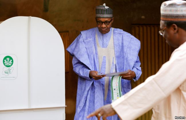 Nigerian President Muhammadu Buhari prepares to cast his vote in Nigeria's election at a polling station in Daura, Katsina State, Nigeria, Feb. 23, 2019.